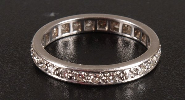 1007: An all diamond eternity ring - finger size R/S -