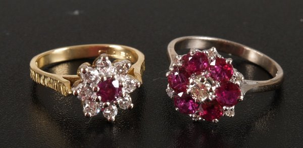 1008: 18ct gold ruby and diamond nine stone cluster rin