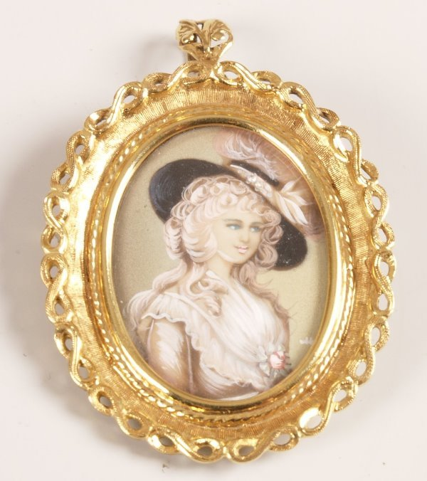 1011: 18k mounted oval brooch with pendant fitting depi