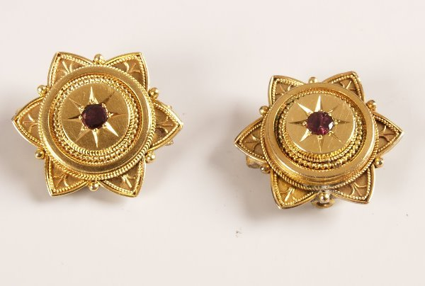 1013: Pair of garnet set brooches in target style with