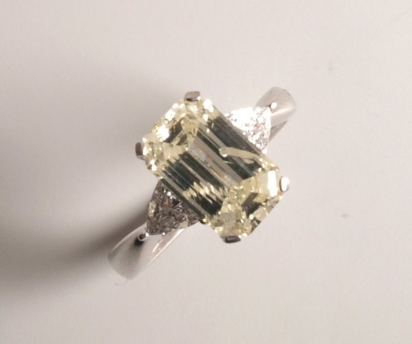 1017: 18ct white gold emerald cut diamond ring with a s