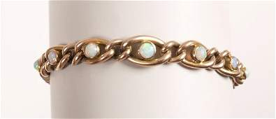 1366: Edwardian 9ct rose gold hollow curb link bracelet