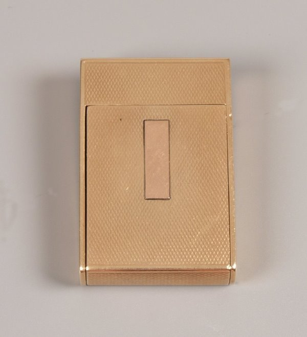 1949:  Asprey - 9ct textured gold petrol lighter, with