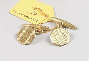 A pair of 1920's 18ct gold octagonal ch