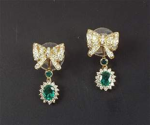 A pair of oval emerald and diamond clus