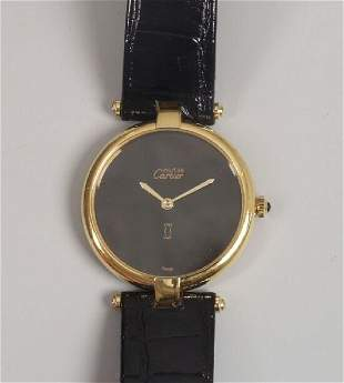 CARTIER - a gentleman's 1950's 9ct gold