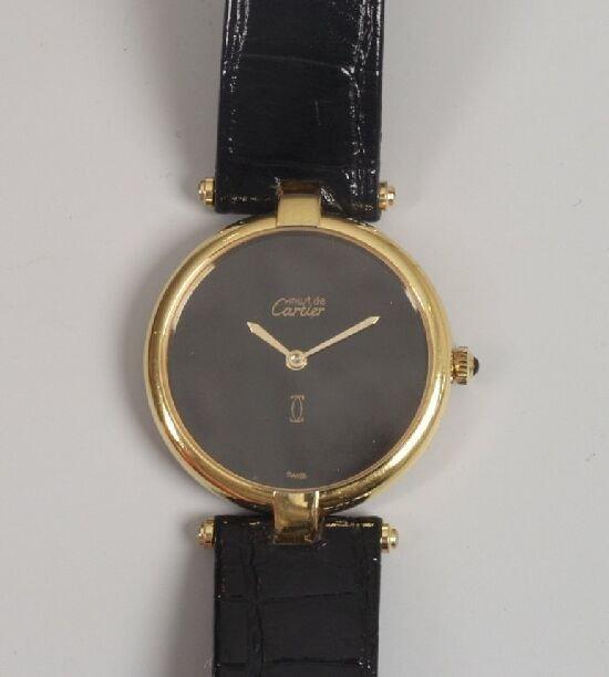 2020: CARTIER - a gentleman's 1950's 9ct gold