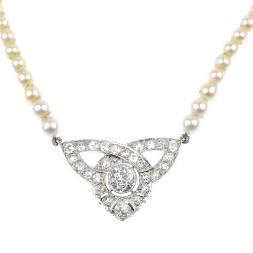 5: An early 20th century diamond and natural pearl pend