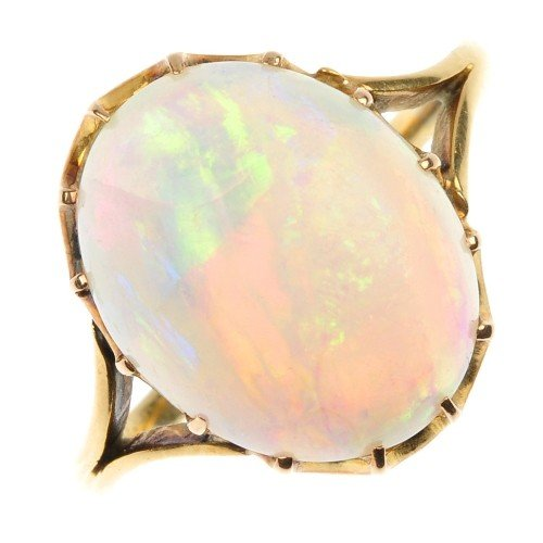 8: An opal ring. The oval opal cabochon to the bifurcat