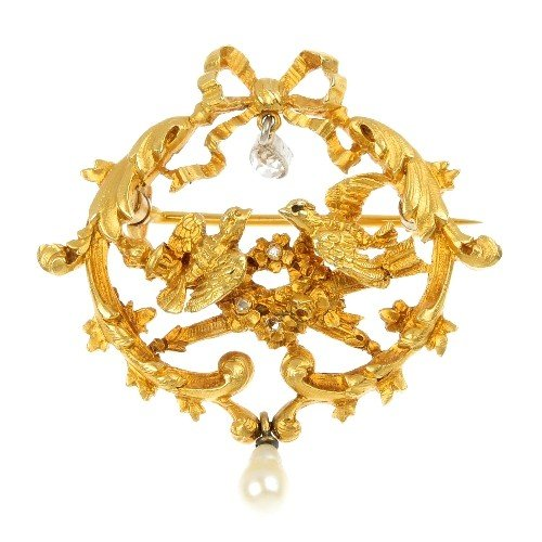 11: A diamond and cultured pearl brooch. Of openwork de