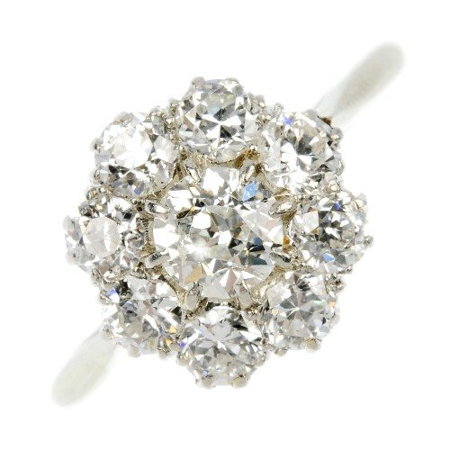 13: A diamond floral cluster ring. The circular-cut dia