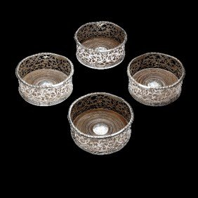 Victorian Set Of Four Silver Mounted Wine Coasters.