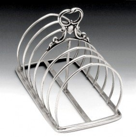 8: A Victorian six divide silver toast rack.