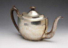 10:  George III silver teapot.