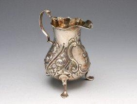 12: George III silver cream jug with pear shaped body,