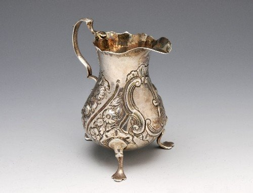 12: George III silver cream jug with pear shaped body,