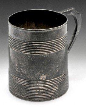 16: A George III silver mug.