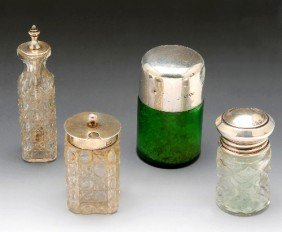 22: Two Victorian silver mounted glass condiments.