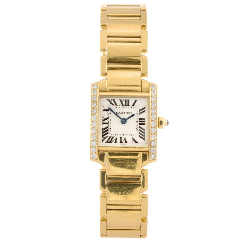 31: CARTIER - an 18k gold quartz lady's Tank Francaise