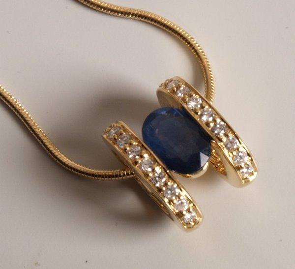 8: 18ct yellow gold ovoid shape pendant set with an ova