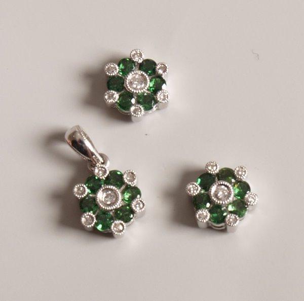 9: Pair 18ct gold green garnet and diamond thirteen sto