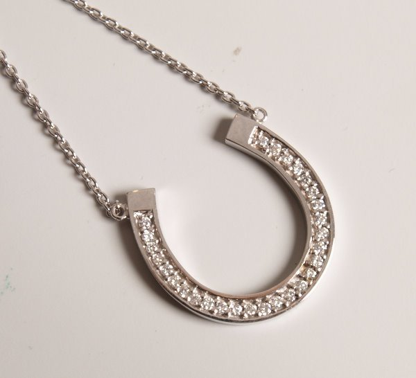 22: 18ct white gold diamond set horseshoe pendant and c