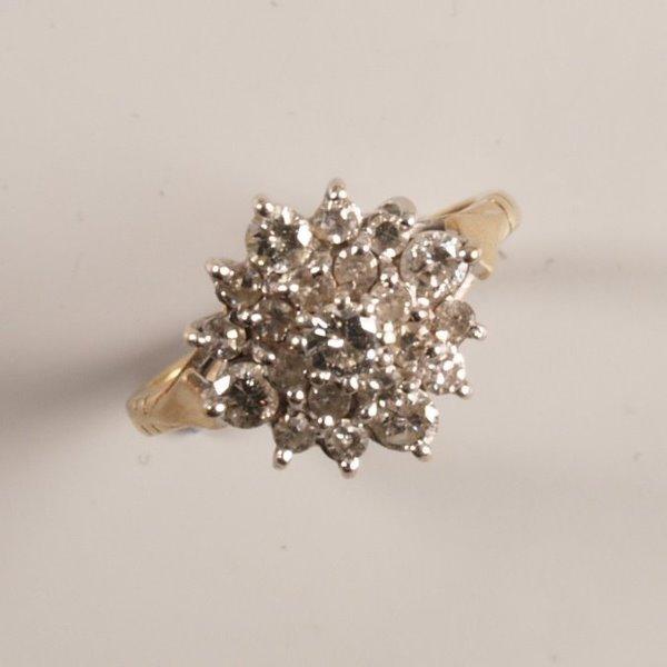 1002: 9ct gold twenty stone claw set diamond two tier r