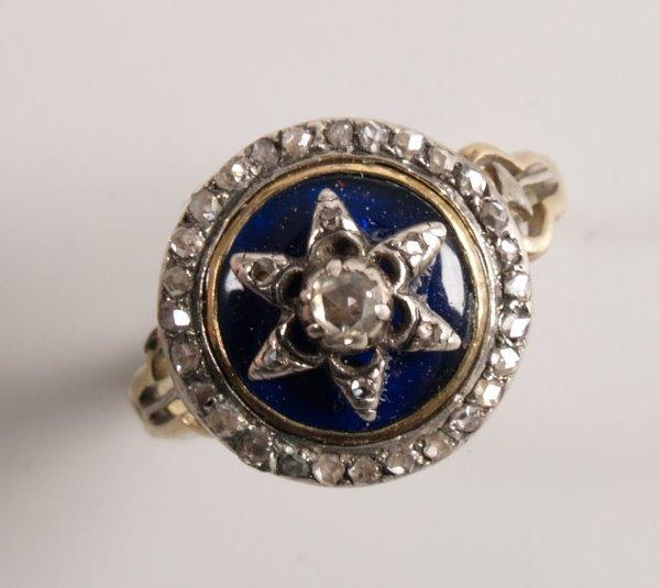 1019:  Georgian circular diamond set ring, with a centr