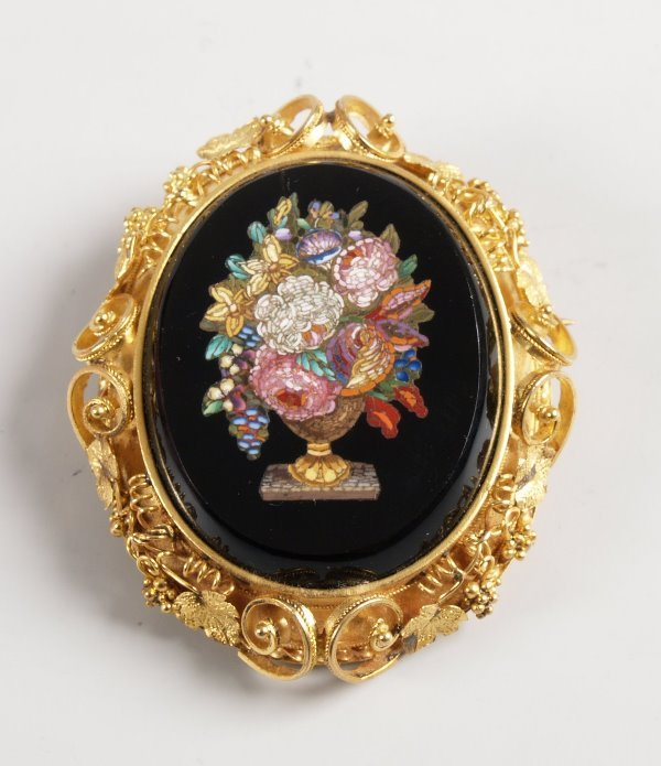 1821:  Oval micro mosaic panel brooch depicting an urn