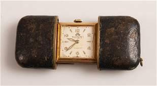 3009  BUCHERER  a black leather cased travel clock wi
