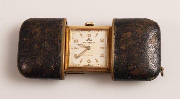 3009:  BUCHERER - a black leather cased travel clock wi
