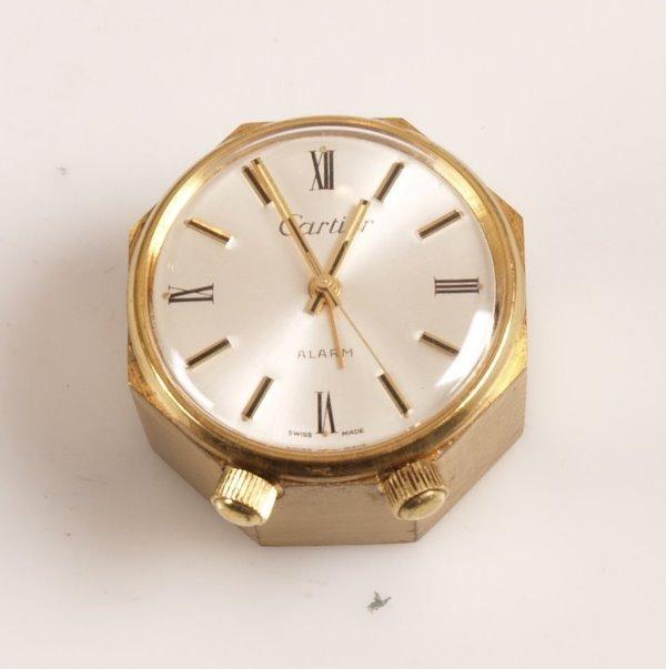 3016: CARTIER - an octagonal  brass brushed finish case