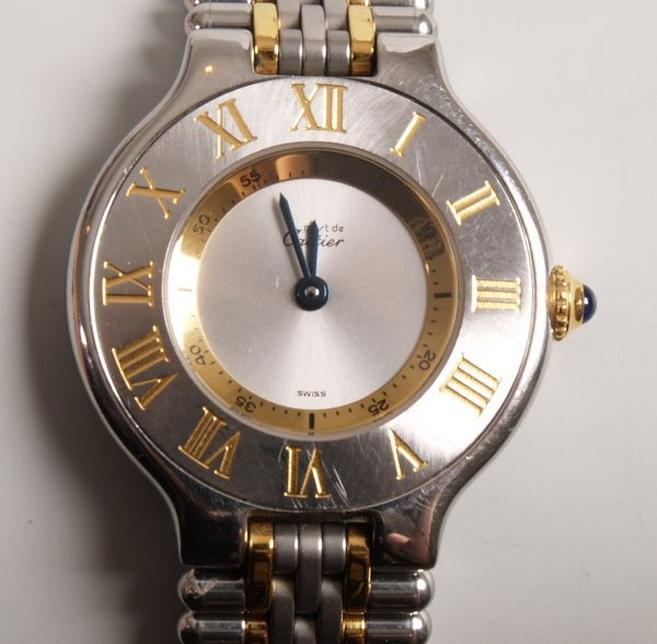 """3019:  CARTIER - a ladies 18ct gold and steel """"Must 21"""""""