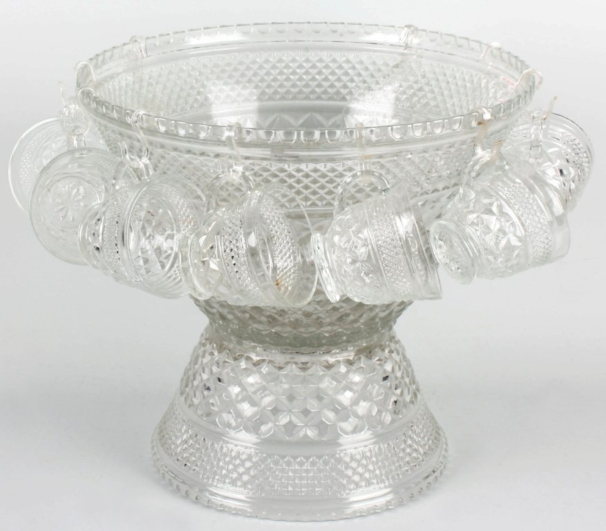 1: A large pressed glass punch bowl