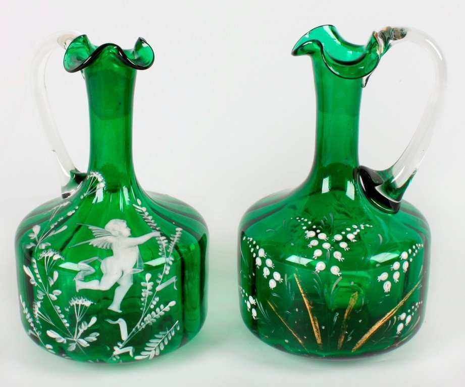 8: Two late 19th century enamelled green glass ewers.