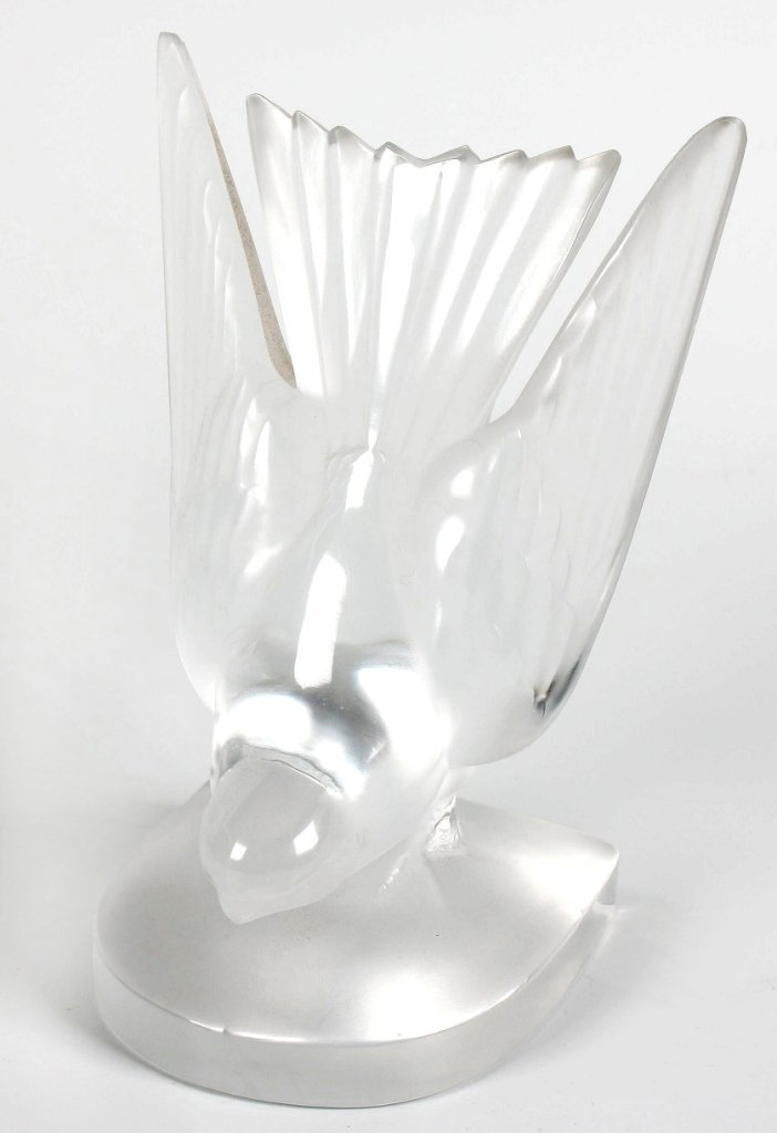 19: A Lalique crystal book end in the form of a swallow