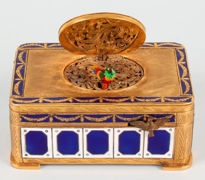 286: A good 20th century gilt brass and enamel singing