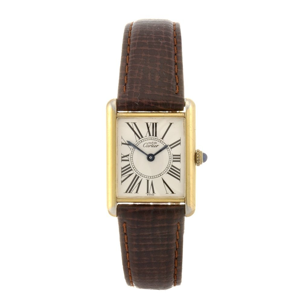 12: A gold plated silver quartz Cartier Must de Cartier