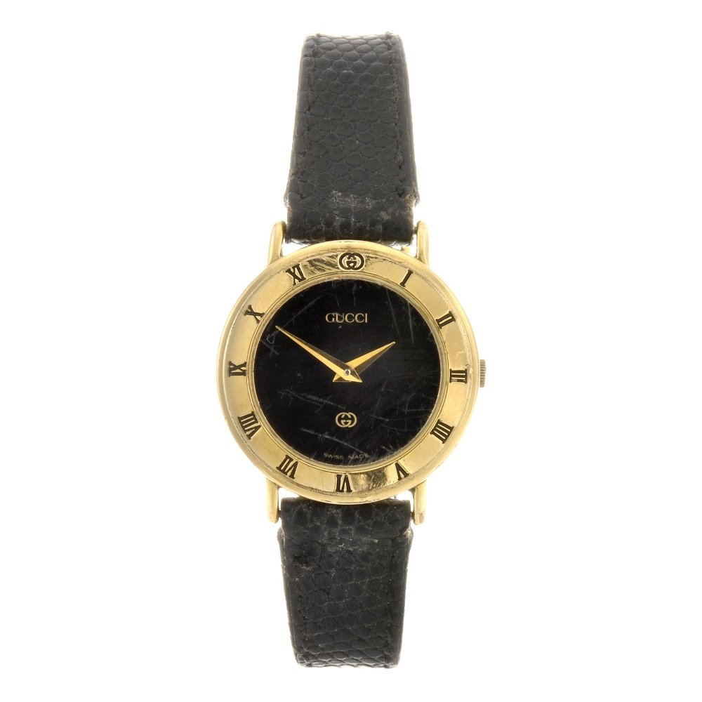 22: A gold plated quartz lady's Gucci 3000L wrist watch