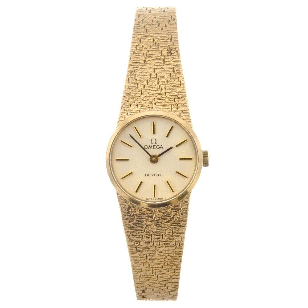 46: A 9ct gold manual wind lady's Omega De Ville bracel