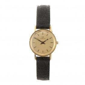 An 18k Gold Quartz Lady's Omega Wrist Watch.
