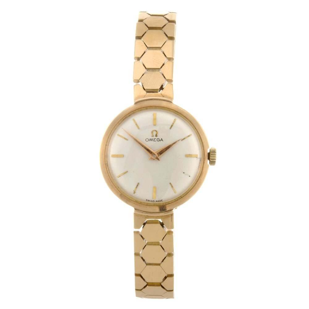 55: (811005237) An 18k gold manual wind lady's Omega br