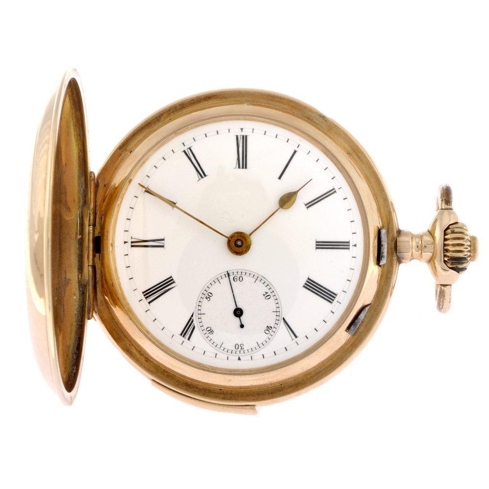 10: An 18k gold keyless wind full hunter pocket watch.