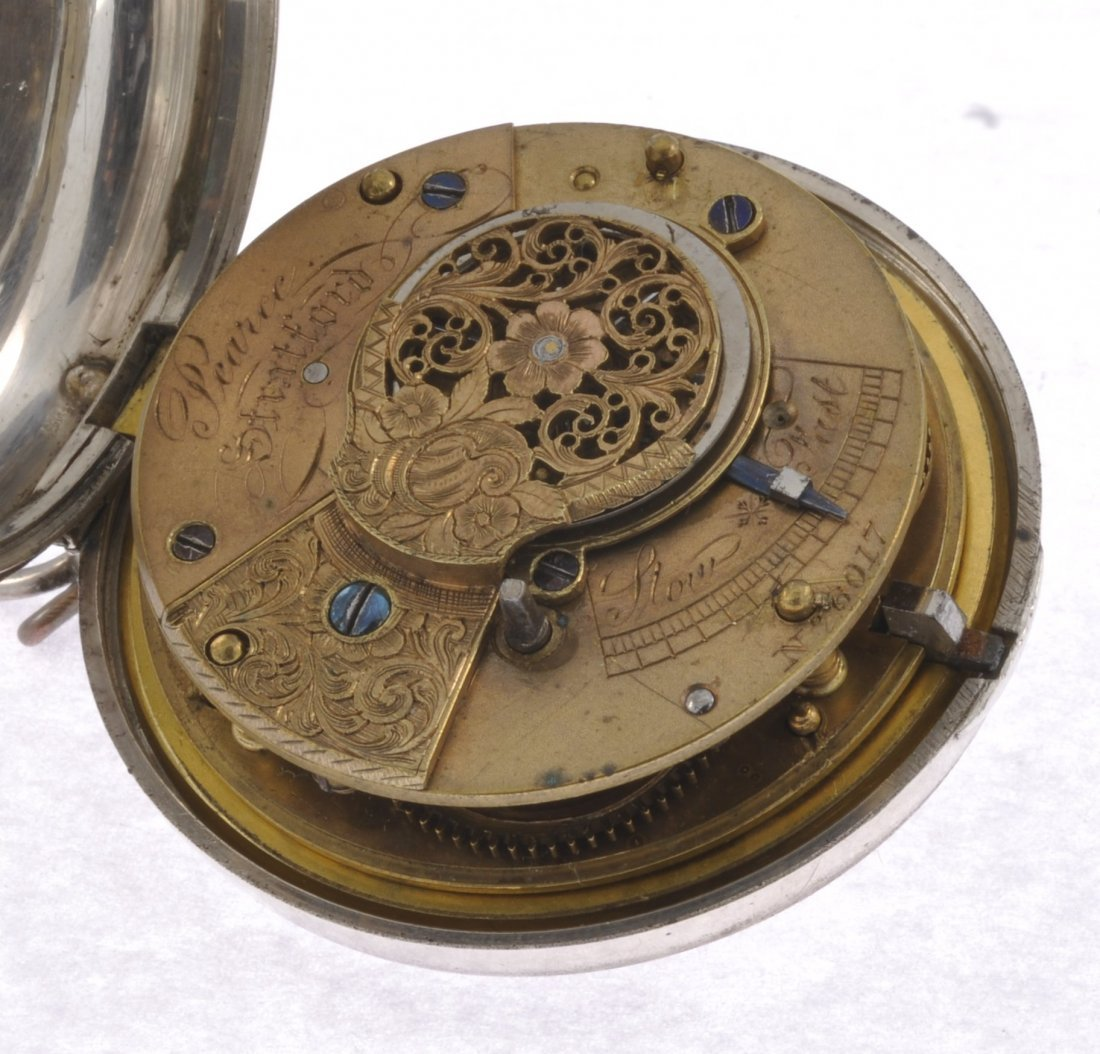 60: A Victorian silver key wind pair case pocket watch. - 4