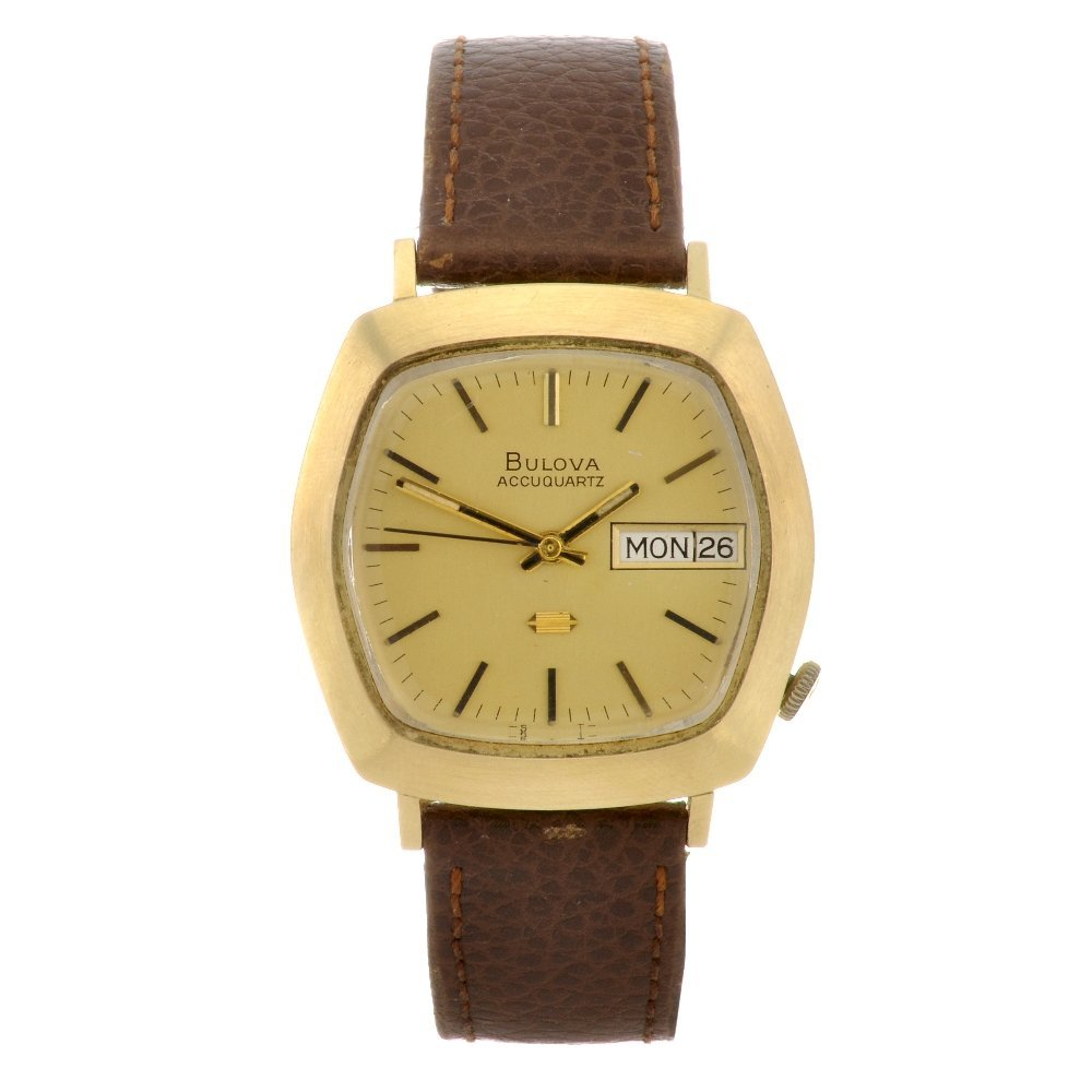 13: (605010032) An 18k gold quartz gentleman's Bulova A