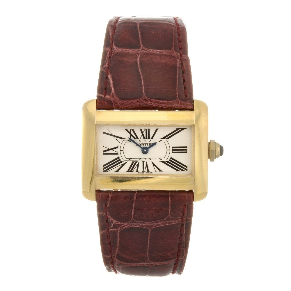 19: (122080638) An 18k gold quartz lady's Cartier Tank