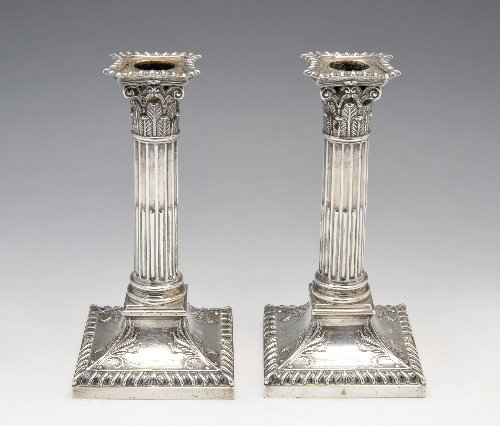 28: Late Victorian silver mounted pair of candlesticks.