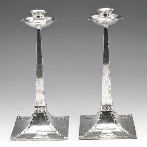 156: A pair of early twentieth century silver candlesti