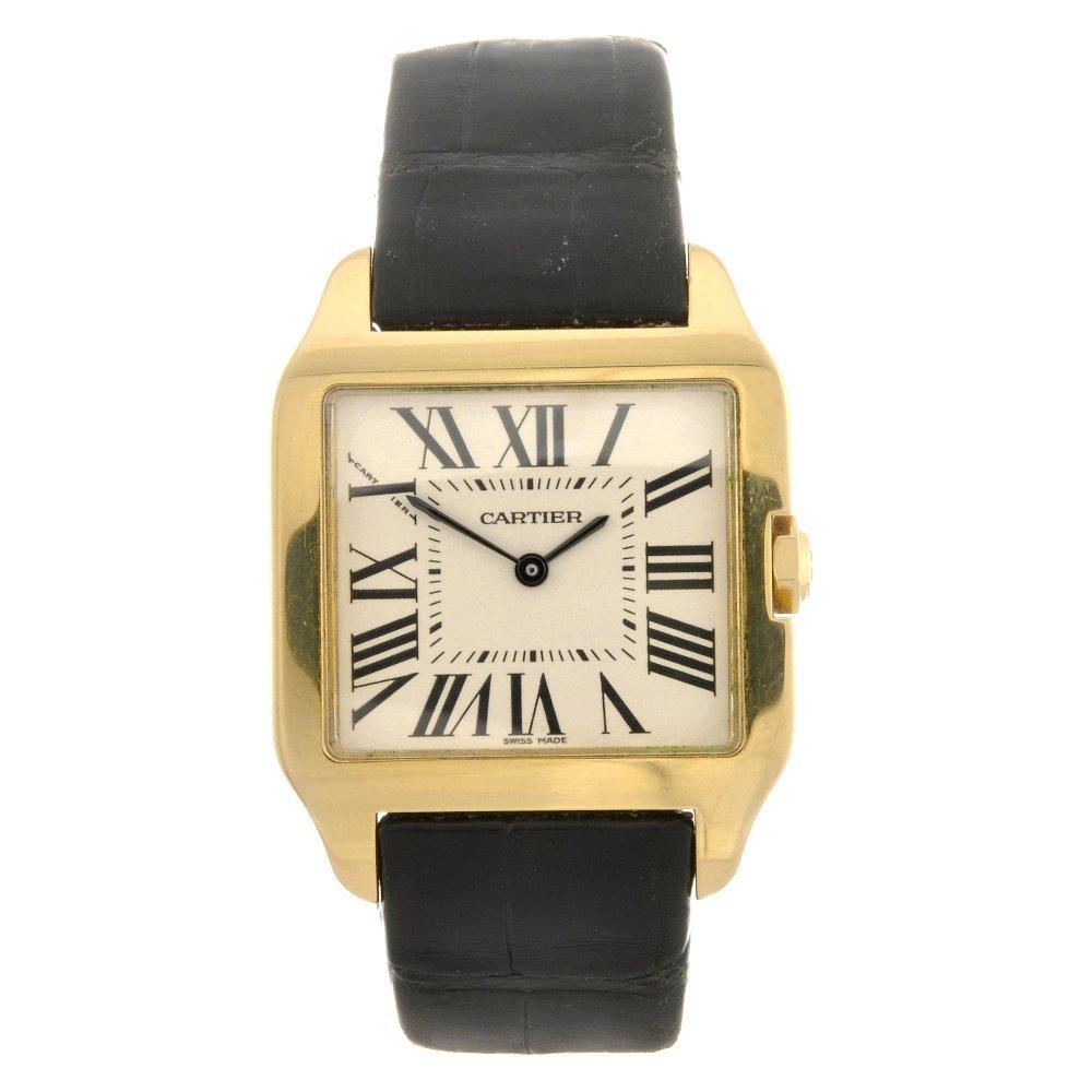 23: (116185813) An 18k gold quartz Cartier Santos Dumon