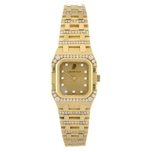 1: (75808) An 18k gold quartz lady's Audemars Piguet br